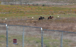 Using horses to check the area, Border Patrol checks the area not far from where the prototype border walls will be constructed along the U.S.-Mexico border. Otay Mesa, San Diego, CA, USA, September 26, 2017. Photo by Nelvin C. Cepeda/San Diego Union-Tribune/TNS/ABACAPRESS.COM