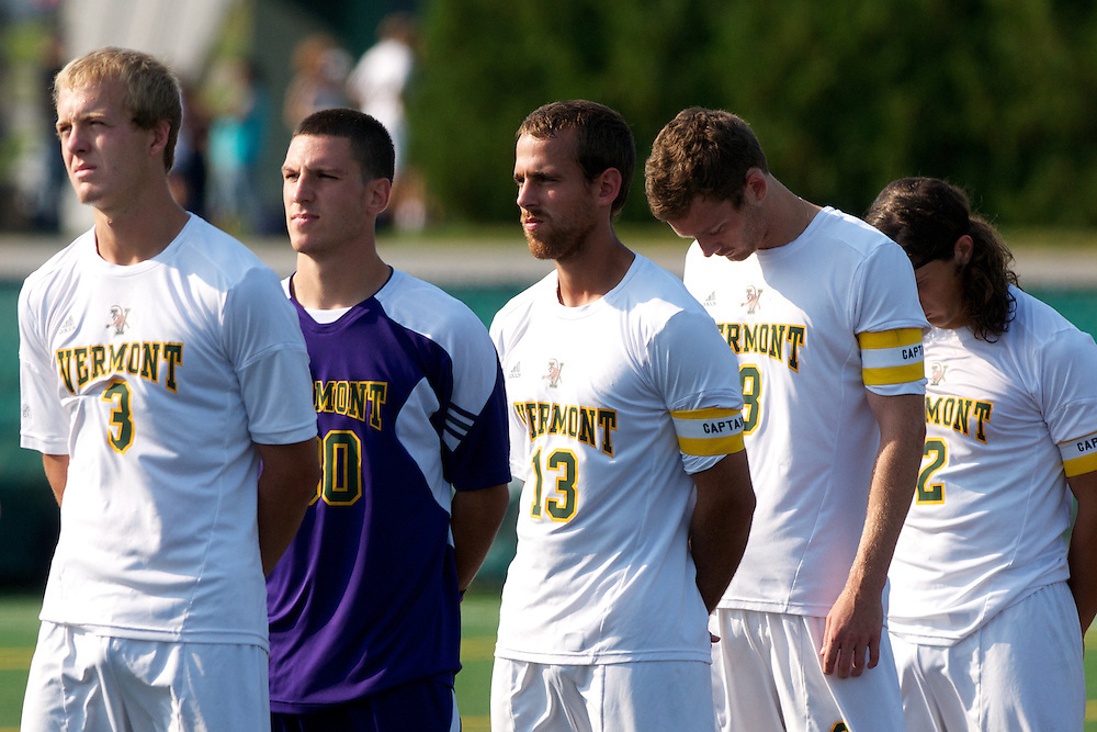 Catamounts defenseman Scott Kisling (3), Catamounts goalie Conor Leland (00), Catamounts defenseman Seth Rebeor (13), Catamounts defenseman Joe Losier (8), and Catamounts defenseman Sean Sweeney (2) listen the the National Anthem before the start of the men's soccer game between the Central Connecticut State University Blue Devils and the Vermont Catamounts at Virtue Field on Friday afternoon September 7, 2012 in Burlington, Vermont.