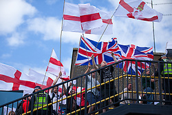 Luton, UK. 27th June, 2015. Members of far-right group Britain First take part in a march through Luton. Police failed to prevent Paul Golding and Jayda Fransen, leader and deputy leader of Britain First, from attending the march, but ensured that they could not carry banners demanding no more mosques. A counter-protest was organised by Unite Against Fascism.