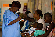 Nurse Konam Aya Marguerite fills information about a patient at the NDA health center in Dimbokro, Cote d'Ivoire on Friday June 19, 2009.