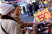 Older women shopping on Jizo Dori shopping street in Sugamo, Tokyo, Japan  Sunday December 16th 2007. Sugamo is affectionately known as the old lady Harajuku, in reference to the Mecca for youth fashions in the South of Tokyo, and is a popular place for Tokyo's increasingly aged population.