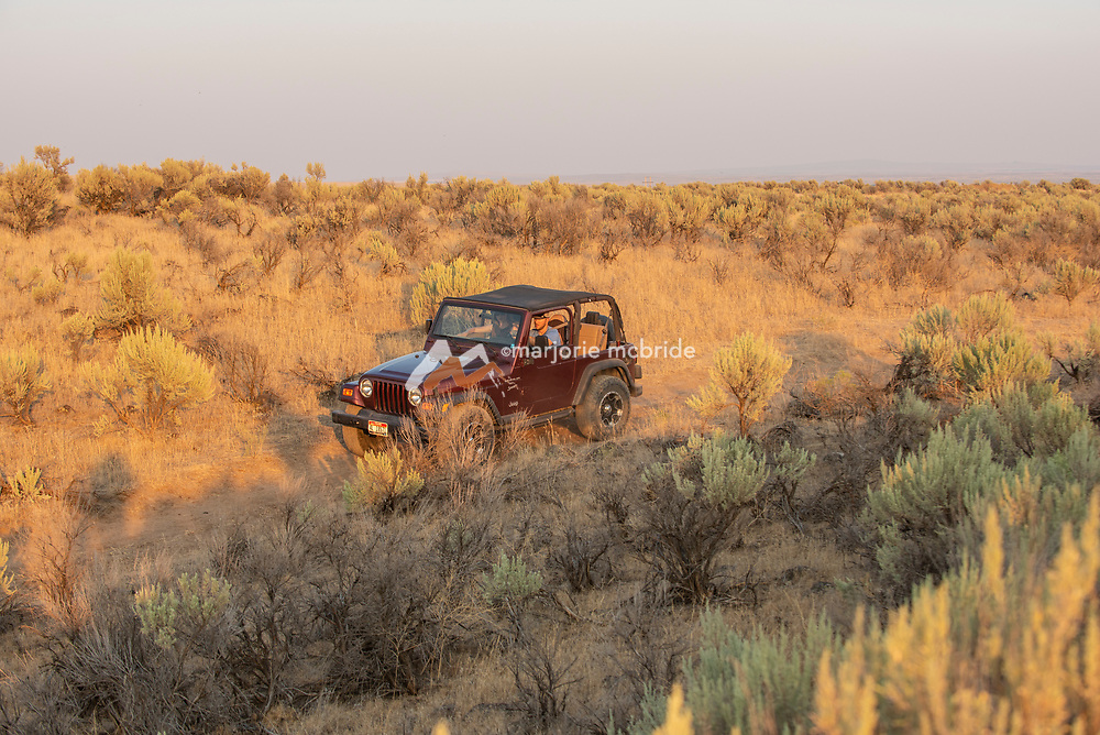 Couple jeeping during evening at the Dietrich Crater in Dietrich, Idaho.