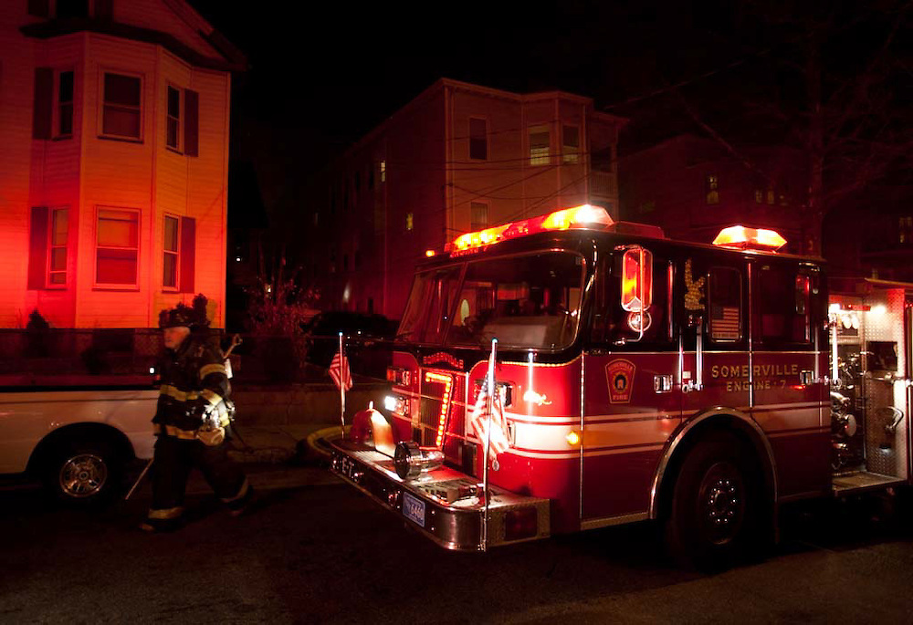 Somerville, MA 02/06/2012.Somerville firefighters leave the scene of a 2 alarm house fire on Jacques St. on Monday evening..Wicked Local Photo by Alex Jones