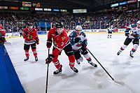 KELOWNA, CANADA - MARCH 2:  Ethan Ernst #19 of the Kelowna Rockets checks Nick Perna #3 of the Portland Winterhawks during third period on March 2, 2019 at Prospera Place in Kelowna, British Columbia, Canada.  (Photo by Marissa Baecker/Shoot the Breeze)