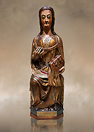 Gothic wood statue of a Saint by the St Bertrand de Cominges Group of artists. Polychrome wood carving with varnished metal-plating.  National Museum of Catalan Art, inv no: 064015-000 .<br /> <br /> If you prefer you can also buy from our ALAMY PHOTO LIBRARY  Collection visit : https://www.alamy.com/portfolio/paul-williams-funkystock/gothic-art-antiquities.html  Type -     MANAC    - into the LOWER SEARCH WITHIN GALLERY box. Refine search by adding background colour, place, museum etc<br /> <br /> Visit our MEDIEVAL GOTHIC ART PHOTO COLLECTIONS for more   photos  to download or buy as prints https://funkystock.photoshelter.com/gallery-collection/Medieval-Gothic-Art-Antiquities-Historic-Sites-Pictures-Images-of/C0000gZ8POl_DCqE