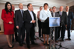 """DUP leader Arlene Foster (centre right) with MP's at the Stormont Hotel in Belfast after Prime Minister Theresa May has announced that she will work with """"friends and allies"""" in the DUP to enable her to lead a government."""