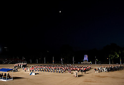 © Licensed to London News Pictures. LONDON, UK  08/06/11. As the opening night of Beating the Retreat draws to a close, the Massed Bands of the Brigade of Guards, the Bands of the Household Cavalry and the US Army Europe Band and Chorus all play in formation beneath a clear sky. This year the opening night of Beating the Retreat took place with the American Ambassador receiving the salute. The traditional parade, involving all of the bands of the Household Division of the British Army, dates back to times when, after a day's battle, troops would retreat for the night.  Please see special instructions for usage rates. Photo credit should read Matt Cetti-Roberts/LNP
