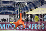 Burnley goalkeeper Will Norris (25) fails from saving Milton Keynes Dons midfielder Scott Fraser (10) scoring during penalties during the FA Cup match between Burnley and Milton Keynes Dons at Turf Moor, Burnley, England on 9 January 2021.