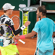 PARIS, FRANCE October 06. Winner Rafael Nadal of Spain and Jannik Sinner of Italy congratulate each other at the net after the Quarter Finals of the singles competition on Court Philippe-Chatrier during the French Open Tennis Tournament at Roland Garros on October 6th 2020 in Paris, France. (Photo by Tim Clayton/Corbis via Getty Images)