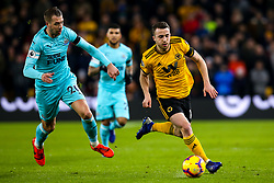 Diogo Jota of Wolverhampton Wanderers goes past Florian Lejeune of Newcastle United - Mandatory by-line: Robbie Stephenson/JMP - 11/02/2019 - FOOTBALL - Molineux - Wolverhampton, England - Wolverhampton Wanderers v Newcastle United - Premier League