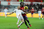 Swansea city's Chico Flores is challenged by WBA's Romelu Lukaku.  Barclays Premier league, Swansea city v West Bromwich Albion at the Liberty Stadium in Swansea on Wednesday 28th November 2012. pic by Andrew Orchard, Andrew Orchard sports photography,