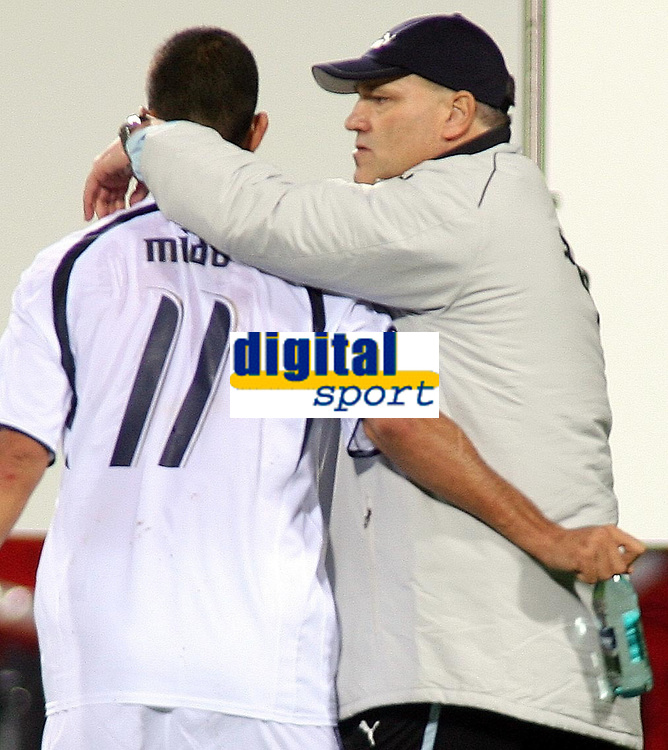 Photo: Paul Thomas.<br /> Bayer Leverkusen v Tottenham Hotspur. UEFA Cup. 23/11/2006.<br /> <br /> Spurs manager Martin Jol (R) talks to Mido after the game.