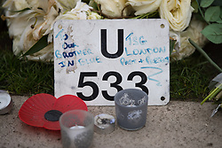© Licensed to London News Pictures . 27/03/2017 . London , UK . Tribute left by TSG police . Flowers and tributes fixed to railings outside Parliament in Westminster , in response to Khalid Masood's terrorist attack and the killing of PC Keith Palmer . Photo credit: Joel Goodman/LNP