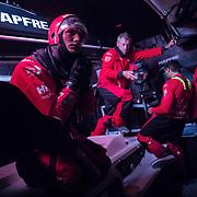 Leg 3, Cape Town to Melbourne, day 11, Blair Take preparing to go on deck on board MAPFRE. Photo by Jen Edney/Volvo Ocean Race. 20 December, 2017.