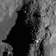The chaotic floor of Necho crater attests to the dynamic environment immediately after the impact event.