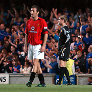 Manchester United's Laurent Blanc and Roy Carroll look dejected after Chelsea's second goal