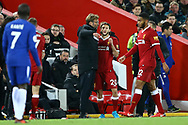 Adam Lallana of Liverpool (20) gets instructions from Liverpool Manager Jurgen Klopp prior to coming on as a substitute, returning after a long injury spell out. Premier League match, Liverpool v Chelsea at the Anfield stadium in Liverpool, Merseyside on Saturday 25th November 2017.<br /> pic by Chris Stading, Andrew Orchard sports photography.