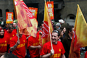 Peaceful demonstration in central London by protesters during the TUC union march against cuts, Saturday March 26th 2011. Around 400,000 people joined the TUC's March for the Alternative to oppose the coalition government's spending cuts. Teachers, nurses, midwives, NHS, council and other public sector workers were joined by students and pensioners to bring the centre of the capital to a standstill and to make their point that the current coalition government is making cuts too fast which they suggest will have a catastrophic effect on jobs and economic recovery. Fire brigade demonnstrators.