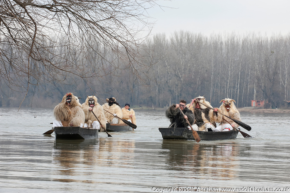 Busó carnival, Mohács, Hungary. On the last Sunday before Lent, the Busós cross the Danube in dug-out wooden boats before gathering for a procession through the town. The Busó carnival or Busójárás is inscribed on the UNESCO list of Intangible Cultural Heritage. © Rudolf Abraham
