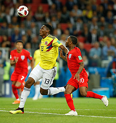 July 3, 2018 - Moscou, Rússia - MOSCOU, MO - 03.07.2018: COLOMBIA VS ENGLAND - Yerry Mina of Colombia contests ball with Raheem Sterling of England during match between Colombia and England valid for the eighth finals of the 2018 World Cup finals, held at the Otkrytie Arena in Moscow, Russia. (Credit Image: © Marcelo Machado De Melo/Fotoarena via ZUMA Press)