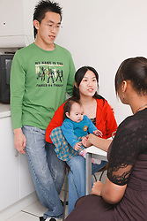 Professional visiting chinese family at home.