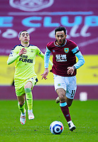 Football - 2020 / 2021 Premier League - Burnley vs. Newcastle United<br /> <br /> Dwight McNeil of Burnley breaks in midfield pursued by Miguel Almiron of Newcastle United, at Turf Moor.<br /> <br /> <br /> COLORSPORT/ALAN MARTIN
