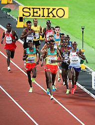 London, August 12 2017 . Selemon Barega, Ethiopia, Yomif Kejelcha, Ethiopia, and Mo Farah, Great Britain, the men's 5000m final on day nine of the IAAF London 2017 world Championships at the London Stadium. © Paul Davey.