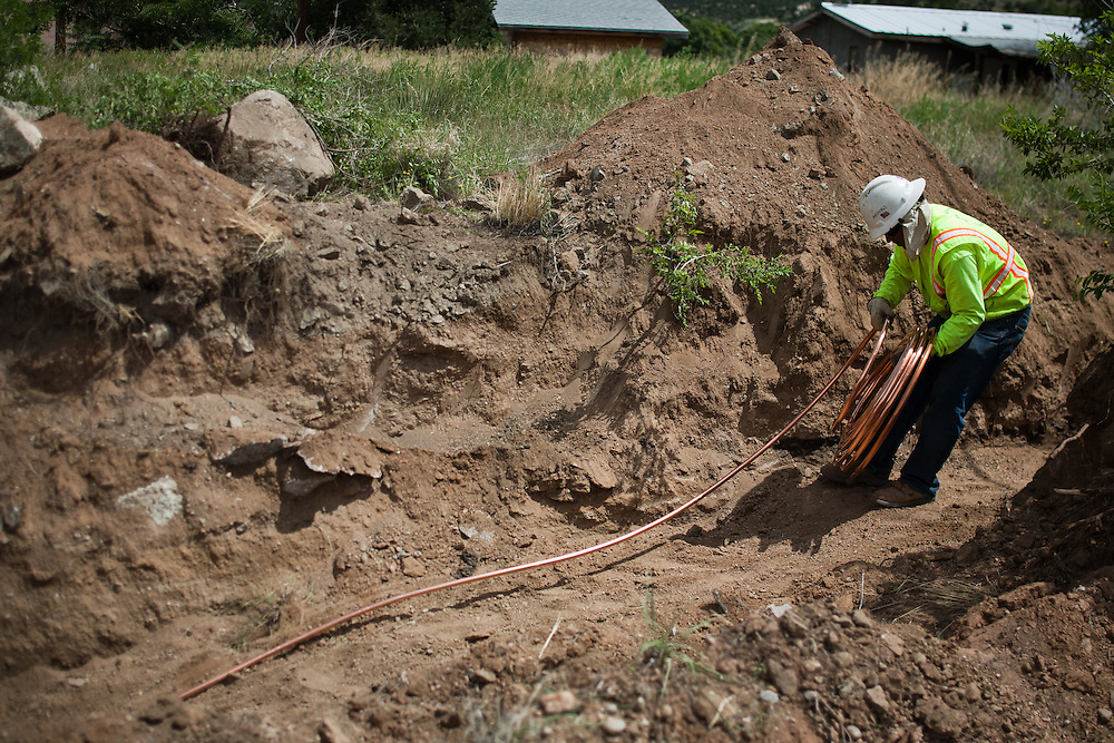 A construction worker lays copper piping as part of the Carnuel Water Systems Improvement Project on August 27, 2010. The $3.4 million project is supported by $2 million from the American Recovery and Reinvestment Act and will provide clean water to hundreds of Bernalillo County residents.