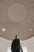 A statue of President Jefferson stands tall in the Jefferson Memorial in Washington, DC.