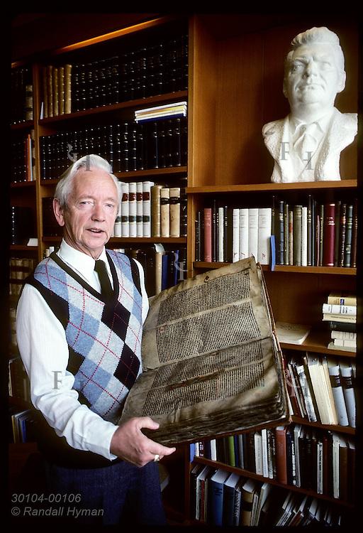 Jonas Kristjansson, Arni Magnusson Institute's director, holds 500-year-old vellum Flateyjarbok Iceland