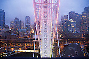 At dusk, The Great Wheel on the Seattle waterfront offers glimmering, dramatic views of the city's skyline and Elliott Bay. The climate-controlled gondolas shield passengers from the elements, while offering vistas from 175-foot tall Ferris Wheel. <br />