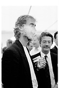 MIKE RUTHERFORD;  JOHN HURT, CARTIER INTERNATIONAL POLO. GUARDS POLO  CLUB, Windsor. 28 July. 1985. <br /> <br /> SUPPLIED FOR ONE-TIME USE ONLY> DO NOT ARCHIVE. © Copyright Photograph by Dafydd Jones 248 Clapham Rd.  London SW90PZ Tel 020 7820 0771 www.dafjones.com