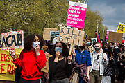 Thousands of people march along the Mall holding placards and signs during a Kill The Bill demonstration as part of a National Day of Action to mark International Workers Day on 1st May 2021 in London, United Kingdom. Nationwide protests have been organised against the Police, Crime, Sentencing and Courts Bill 2021, which would grant the police a range of new discretionary powers to shut down protests.
