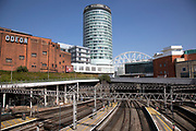 Empty train tracks leading from Grand Central Station, aka Birmingham New Street Station witht he iconic Rotunda tower in Birmingham city centre, which is virtually deserted due to the Coronavirus outbreak on 24th April 2020 in Birmingham, England, United Kingdom. Following government advice most people are staying at home leaving the streets quiet, empty and eerie. Coronavirus or Covid-19 is a new respiratory illness that has not previously been seen in humans. While much or Europe has been placed into lockdown, the UK government has announced a continuation of stringent rules as part of their long term strategy, and in particular social distancing.