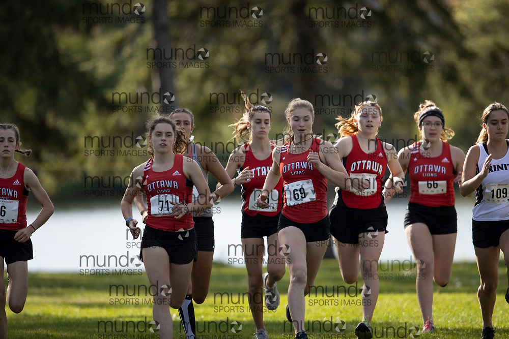 If you post on social media please tag @mundosportimages on Instagram or tag Mundo Sport Images on Facebook.<br /> <br /> (Ottawa, Canada---01 October 2021) \L-R, Gillian Porter, Grace Munro, Andie Harris, Paige Quinn, and Isabelle Honegger racing in the High School Senior Varsity Women's 5km race at the 2021 Capital Cross Country Challenge held at Mooney's Bay in Ottawa.  Photograph 2021 Copyright Sean Burges / Mundo Sport Images