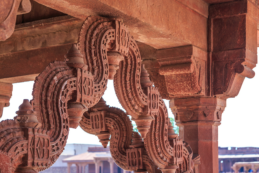 Exquisite stone brackets of the Astrologer's seat in Fatehpur-Sikri, India. The presence of this kiosk near the treasury suggests that it could have been the place where the emperor could sit occasionally to see the distribution of copper, silver and gold coins.