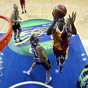 Fenerbahce's Angel MCoughtry (R) and Galatasaray's Sylvia Fowles (C) during their Turkish Basketball woman league derby match Fenerbahce between Galatasaray at Ulker Sports Arena in Istanbul, Turkey, wednesday, December 26, 2012. Photo by Aykut AKICI/TURKPIX