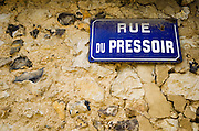 Street sign on stone wall, Giverny, Normandy, France