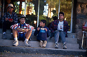 Camp Chiricahua kids on front porch at 6 a.m. birdwatching and eating breakfast, Portal, Arizona..Media Usage:.Subject photograph(s) are copyrighted Edward McCain. All rights are reserved except those specifically granted by McCain Photography in writing...McCain Photography.211 S 4th Avenue.Tucson, AZ 85701-2103.(520) 623-1998.mobile: (520) 990-0999.fax: (520) 623-1190.http://www.mccainphoto.com.edward@mccainphoto.com.
