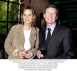 MR DAVID & the HON.MRS MONTGOMERY, he was former Chief Executive of the Mirror Group, at a party in London on 1st May 2002.OZN 50