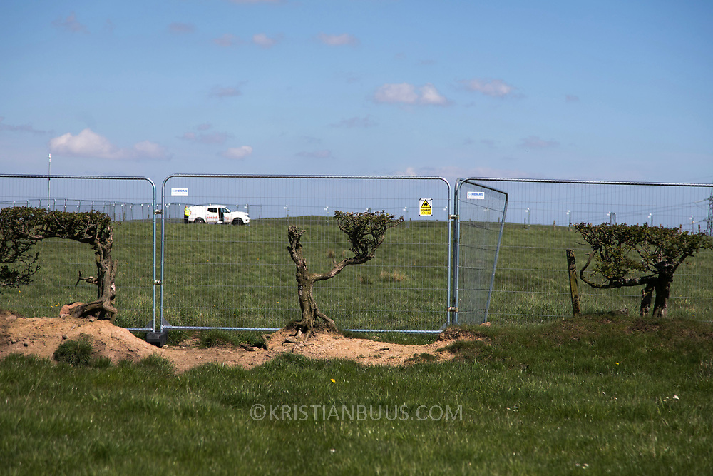 The mining site protected by permanent security pressence. Ancient hedges are partly gone with the habitat. Day of protest in Pont Valley 5 may 2018 against the extraction of coal by the mining company Banks outside Dipton in Pont Valley, County Durham. Locals have fought the open cast coal mine for thirty years and three times the local council rejected planning permissions but central government has overruled that decision and the company Banks was granted the license and rights to extract coal in early 2018. Locals have teamed up with climate campaigners and together they try to prevent the mining from going ahead. The mining will have huge implications on the local environment and further coal extraction runs agains the Paris climate agreement. A rare species of crested newt live on the land planned for mining and protectors are trying to stop the mine to save the newt.