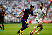 """""""Spanish  League""""- match Real Madrid Vs FC Barcelona- season 2014-15 - Santiago Bernabeu Stadium - Isco (Real Madrid) and Lionel Messi (FC Barcelona) in action during the Spanish League match(Photo: Guillermo Martinez / Bohza Press / Alter Photos)"""