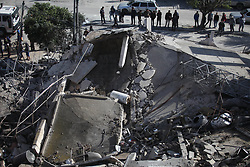 March 26, 2019 - Gaza City, Gaza Strip, Palestinian Territory - Palestinians inspect the remains of a Hamas insurance office following an Israeli air strike on Gaza city. Israel launched air strikes in the Gaza Strip on Monday after a rocket attack near Tel Aviv wounded seven people  (Credit Image: © Mahmoud Ajjour/APA Images via ZUMA Wire)