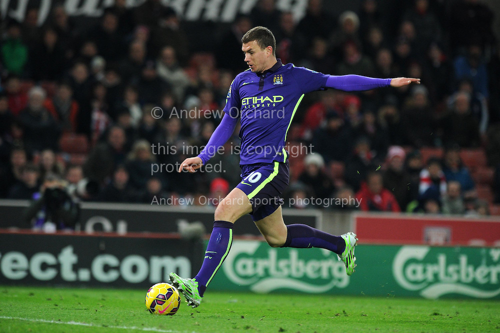 Edin Dzeko  of Manchester city in action.Barclays Premier League match, Stoke city v Manchester city at the Britannia Stadium in Stoke on Trent , Staffs on Wed 11th Feb 2015.<br /> pic by Andrew Orchard, Andrew Orchard sports photography.
