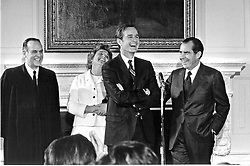 Washington, D.C - February 26, 1971 -- George H.W. Bush shares a light moment after he is sworn-in as United States Ambassador to the United Nations in Washington, D.C. on February 26, 1971. From left to right: Associate Justice of the United States Supreme Court Potter Stewart, Mrs. George H.W. Bush (Barbara), George H.W. Bush, United States President Richard M. Nixon. Photo by White House/CNP/ABACAPRESS.COM