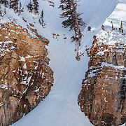 Hadley Hammer drops a monster air in the Teton backcountry after a record breaking 100 inch snow storm near Jackson Hole Mountain Resort in Teton Village, Wyoming.