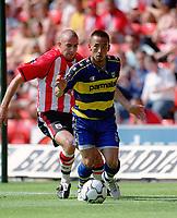 Hidetoshi Nakata (Parma) Danny Higginbotham (Southampton) Southampton v Parma, Pre-Season Friendly, 9/08/2003. Credit: Colorsport / Matthew Impey