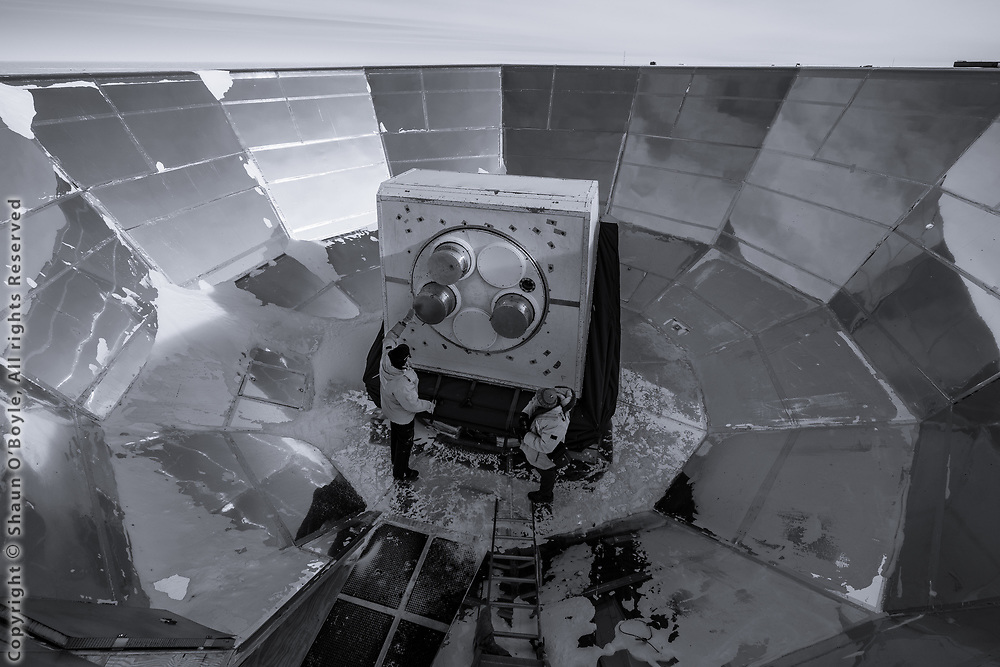 Inside the ground shield of the Keck Array Telescope with 2 of the receivers removed as part of the upgrade of the telescope to the BICEP Array Telescope.