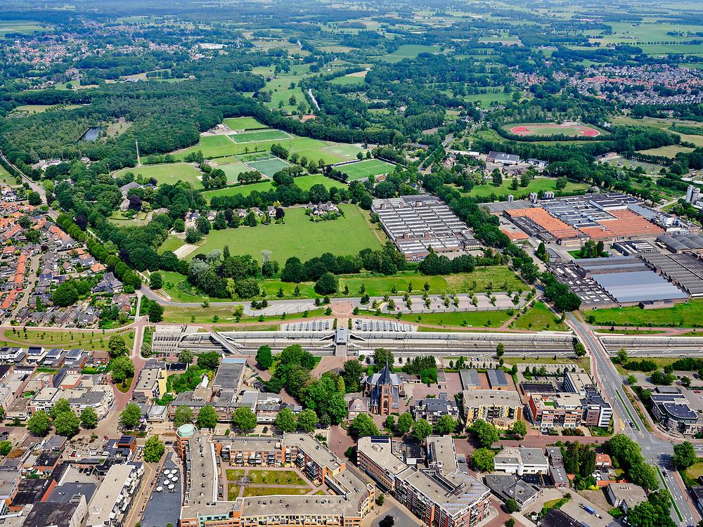 Nederland, Overijssel, Gemeente Hellendoorn; 21–06-2020; Twente, Nijverdal. Zicht op de kerk  St. Antonius van Padua, NS station en fabriek van TenCate. Centrum van de stad met Salland-Twentetunnel. Sinds 2015 lopen de spoorlijn Zwolle - Almelo en provinciale weg N35 door deze combitunnel.<br /> Twente, Nijverdal. City center with Salland-Twente tunnel. The Zwolle - Almelo railway line and the N35 provincial road are running through this combination tunnel.<br /> <br /> luchtfoto (toeslag op standaard tarieven);<br /> aerial photo (additional fee required)<br /> copyright © 2020 foto/photo Siebe Swart