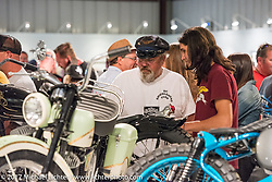 Knucklehead master Carl Olsen talks with custom builder Chris Milanowski at the Old Iron - Young Blood exhibition media and industry reception in the Motorcycles as Art gallery at the Buffalo Chip during the annual Sturgis Black Hills Motorcycle Rally. Sturgis, SD. USA. Sunday August 6, 2017. Photography ©2017 Michael Lichter.